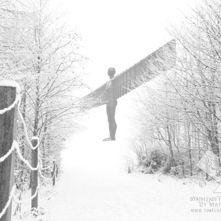 angel of the north covered in snow photo